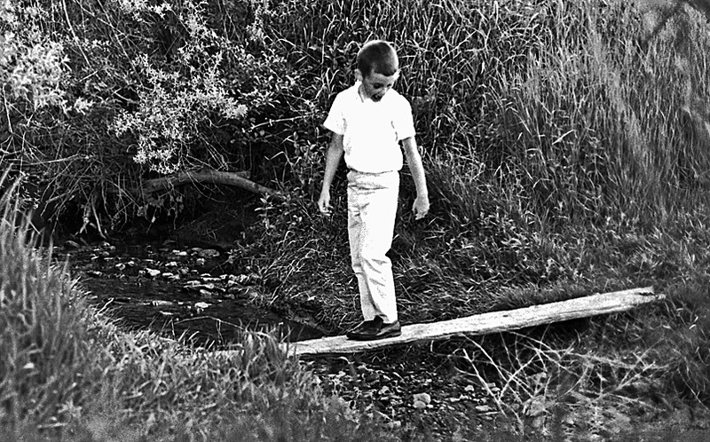 1966 CO James crosses a bridge behind the house on Owens