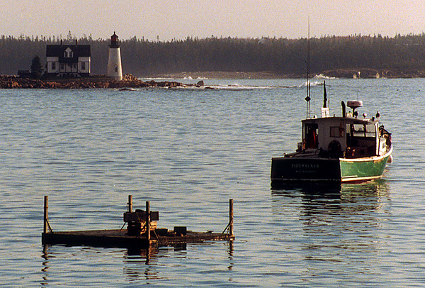 1996 ME Small lighthouse and boat