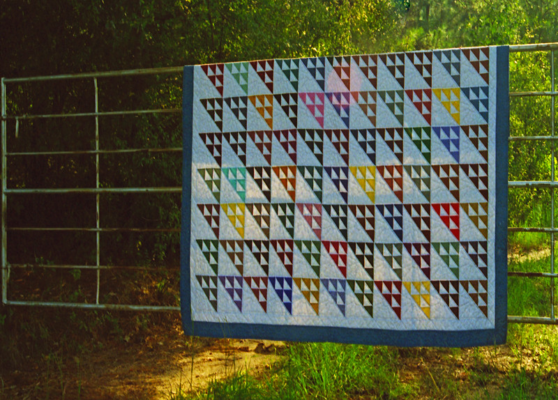 1995 Birds in the air queen quilt on a rural Texas gate