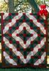 1996 Colorado log cabin queen quilt with red teddy bear in La Grange, Texas.